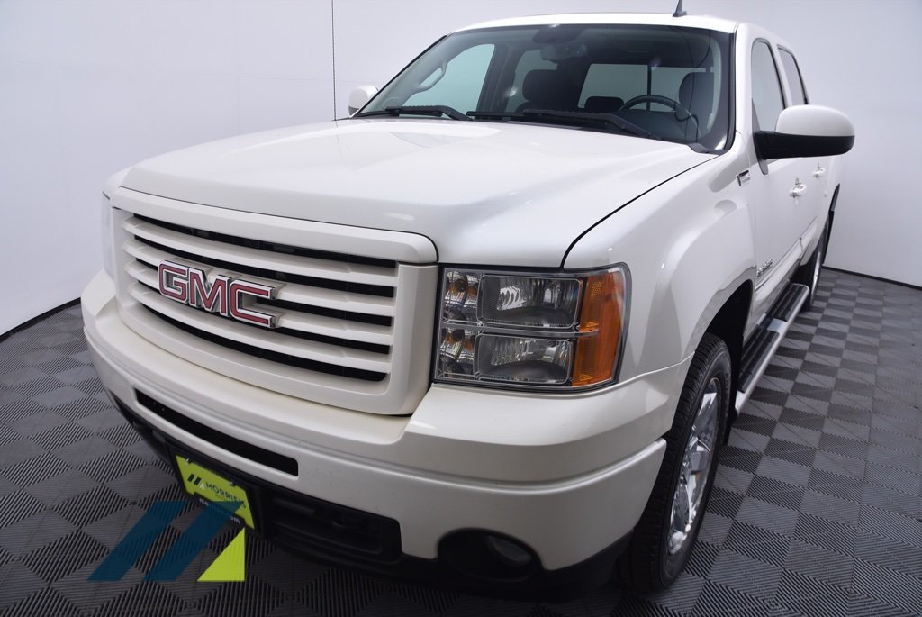 Pre-Owned 2012 GMC Sierra 1500 4WD Crew Cab 143.5